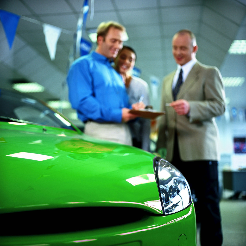 Buyers signing a vehicle agreement