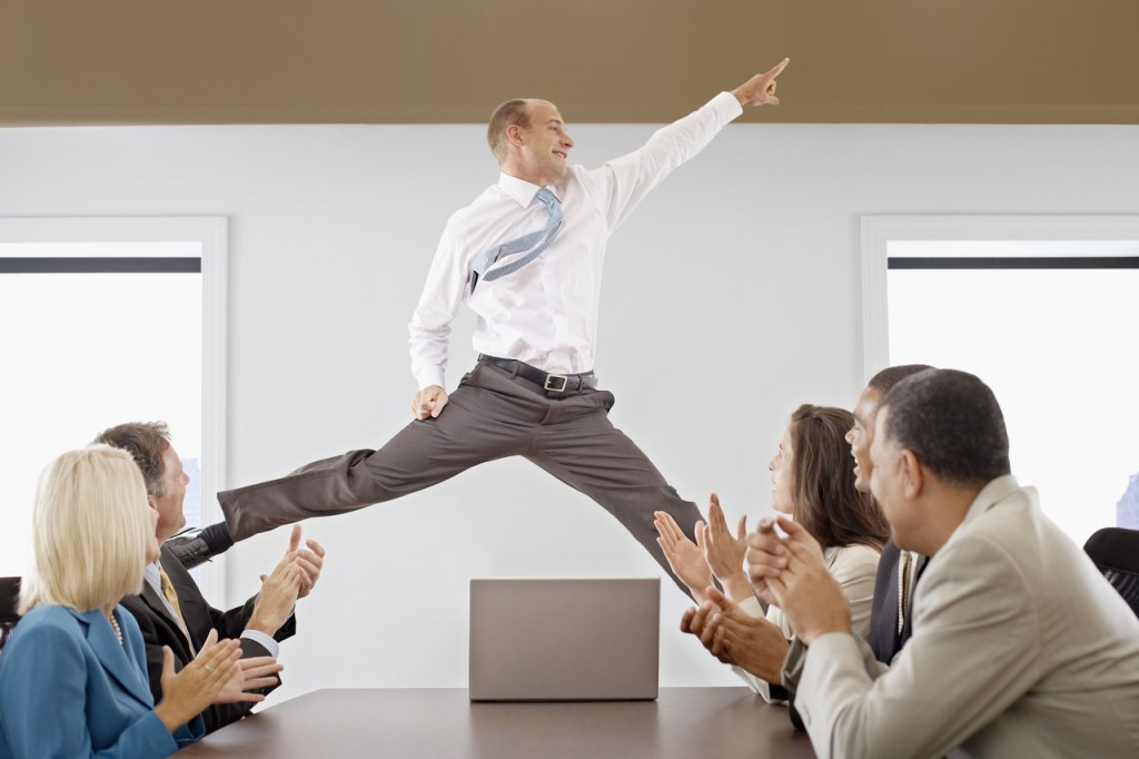 Man jumping in front of coworkers