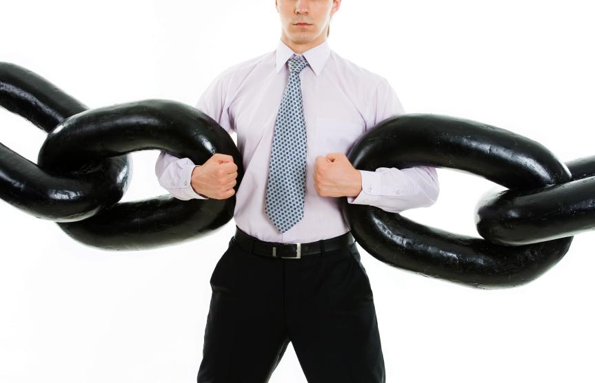 Businessman holding chains